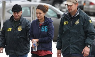 Dawn Nguyen arrested. Photo by Jamie Germano/AP.