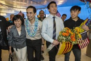 Dr. Nguyen Quoc Quan returns home. Photo by Ringo H.W. Chiu / AP.