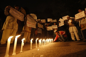 A candlelight vigil for a gang rape victim. Photo by Adnan Abidi/Reuters.