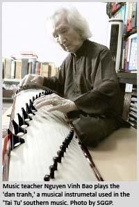 Music teacher Nguyen Vinh Bao plays the 'dan tranh,' a musical instrumetal used in the 'Tai Tu' southern music.