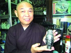 Da Nang monk Thich Tu Nghiem holds one of over 200 Buddhist statues.