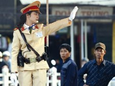 A police woman directing traffic in Hanoi.