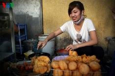 A street vendor working in Hanoi