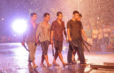 A scene from Charlie Nguyen's action movie Bui doi Cho Lon, which was scheduled to premiere April 19, 2013. The censors have said the film needs to tone down its violence and be more realistic in its portrayal of Saigon gangsters before it can be released. Photo courtesy of Bui doi Cho Lon Facebook page