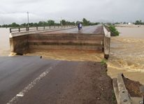 A bridge damaged by flooding caused by a storm