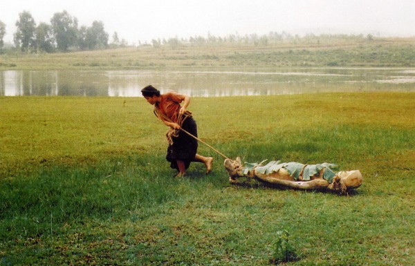 Cam drags her master's wooden statue of his dead fiancé to dump into the river. Cam is a brilliant new character to counterpart the idea of Woman in Nguyễn Tuân's original story