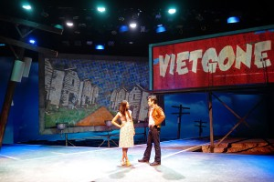 Maureen Sebastian as Tong and Raymond Lee as Quang, against the comic book-esque set of Vietgone. Photo courtesy of South Coast Repertory.