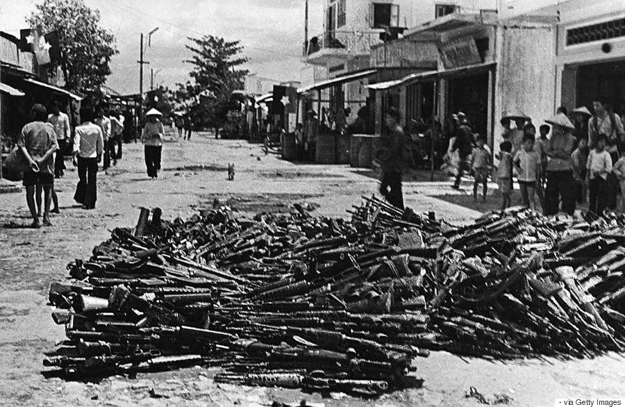 (VIETNAM-25, 1/3) A 01 May 1975 photo shows a large pile of US-made rifles abandoned by pro-American Southern Vietnamese army soldiers collected at Nhan Nghia commune, Chau Thanh district, in the southern province of Can Tho one day after Saigon fell to communist troops. Few young Vietnamese express much interest in the war, even though it scarred the lives of the parents and grandparents. AFP PHOTO (Photo credit should read -/AFP/Getty Images)