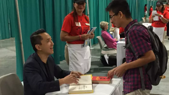 Viet Thanh Nguyen signing a book in Washington, DC.
