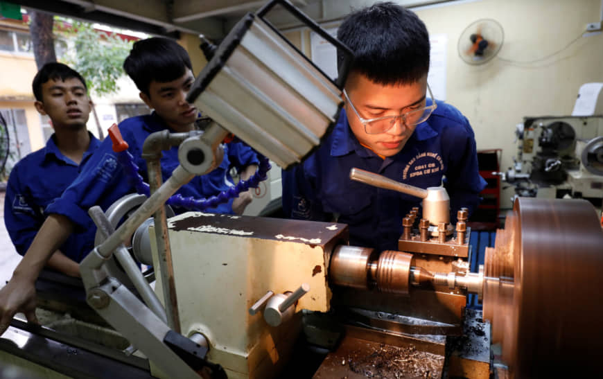 Students at a lab of an industrial vocational training college in Hanoi